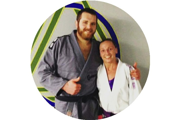 Heather after receiving her purple belt in Brazilian Jiu Jitsu