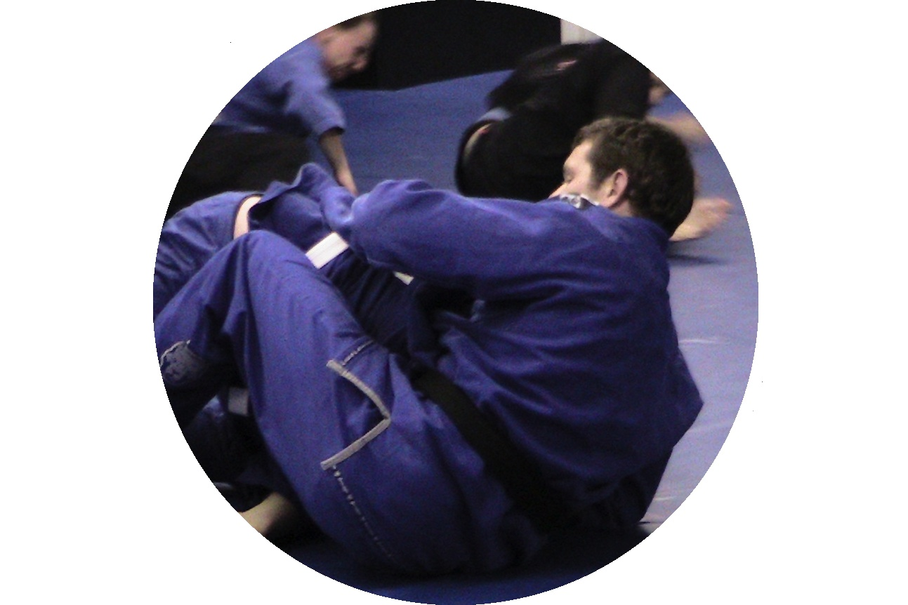 Martial arts students sparring or rolling as it is called in Brazilian Jiu Jitsu