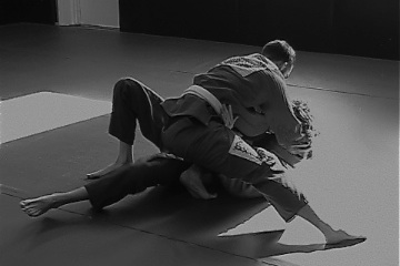 Jiu Jitsu position of knee on belly being used to pin another martial artist down